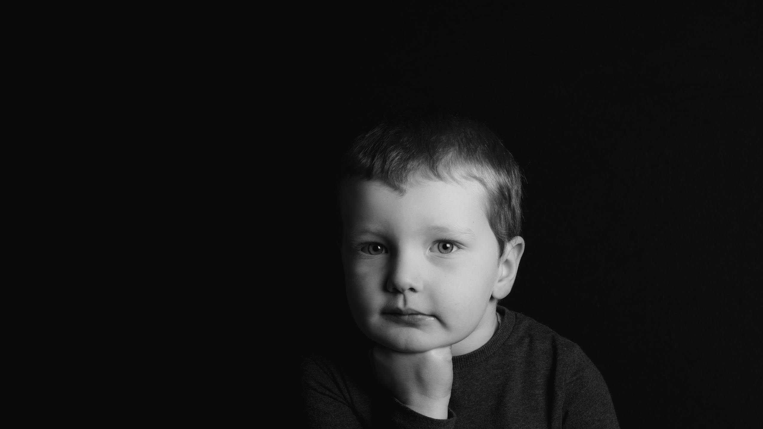 grayscale photo of boy in crew neck shirt